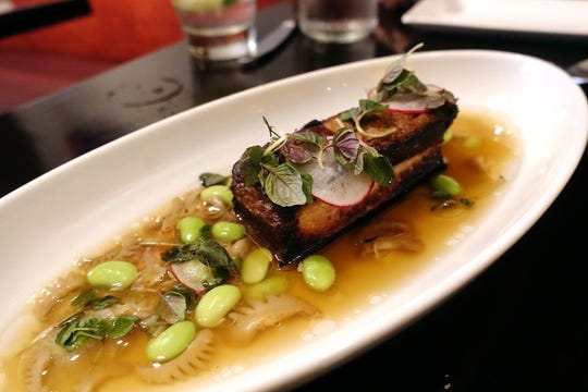 Smoked pork belly with shiso, edamame, radish and cockscomb broth at Confluence in Carefree.
