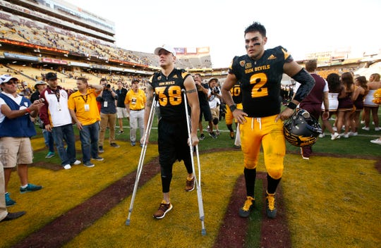 ASU defensive back Jordan Simone (38) leaves the field on crutches after suffering a knee injury against Washington on Nov. 14, 2015 in Tempe, Ariz.