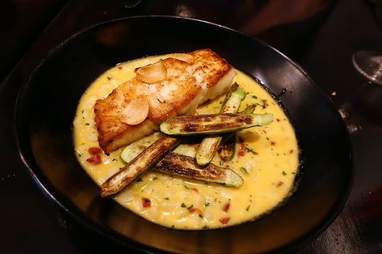 Wild Alaskan halibut with squash, Iberico chorizo, vanilla, crispy garlic and corn at Confluence in Carefree.