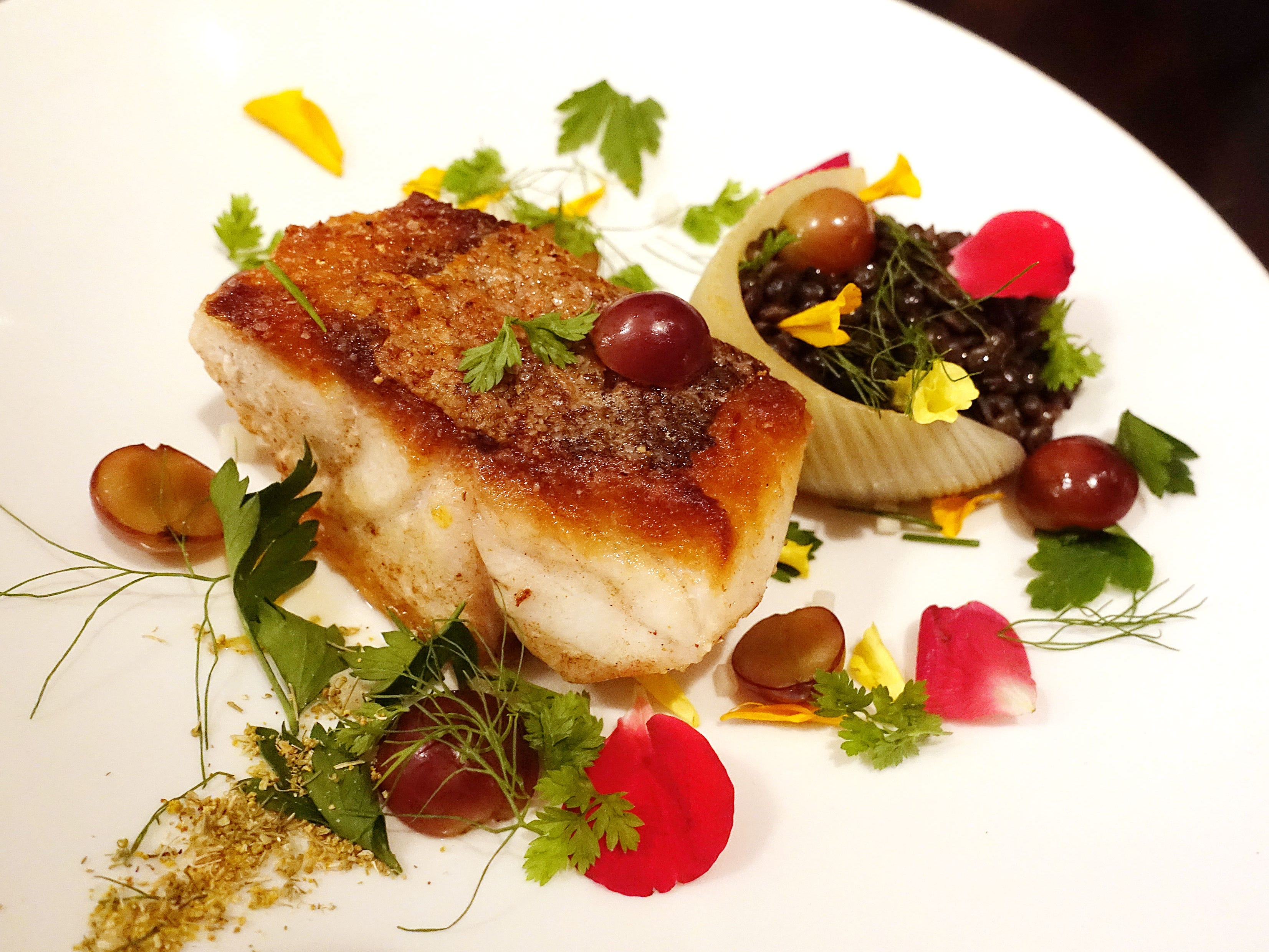 American red snapper with cucumber, grapes, herbs, flowers, lentils, fennel and Calabrian chile at Confluence in Carefree.