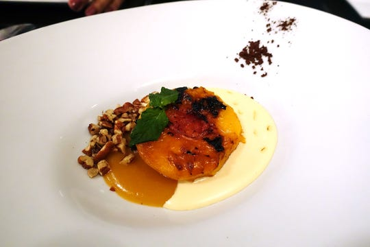 Roasted peach with cocoa, Epoisses, mint, pecans and honey at Confluence in Carefree.