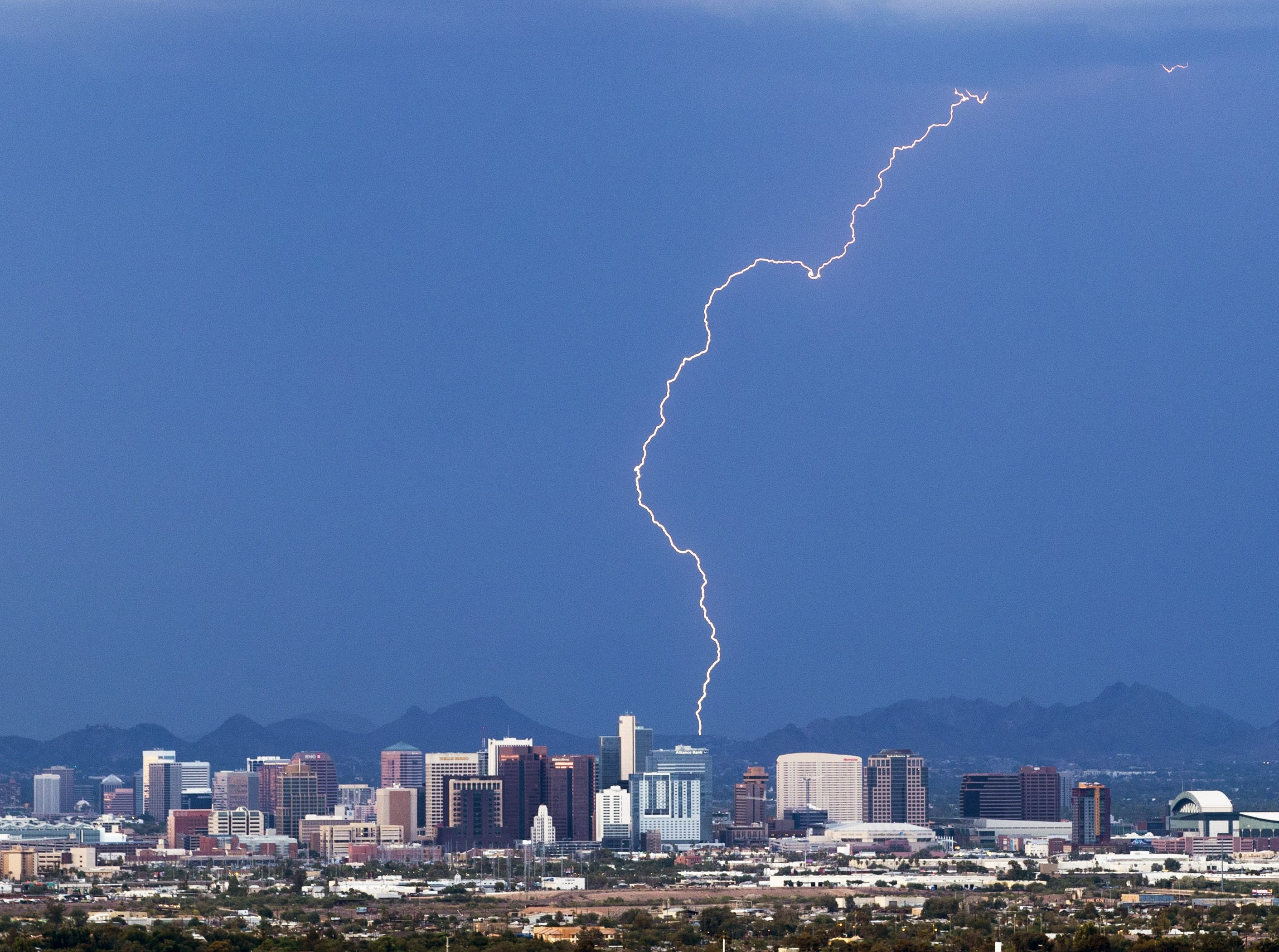Lightning strikes behind downtown Phoenix on Aug. 8, 2018.