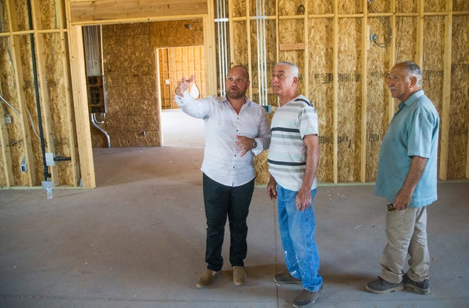 Ephrem Jando (left), Assyrian Church of the East project manager, talks about the future Assyrian Church of the East with Albert Sangar, Church Building Committee member, in Gilbert on May 31, 2018.
