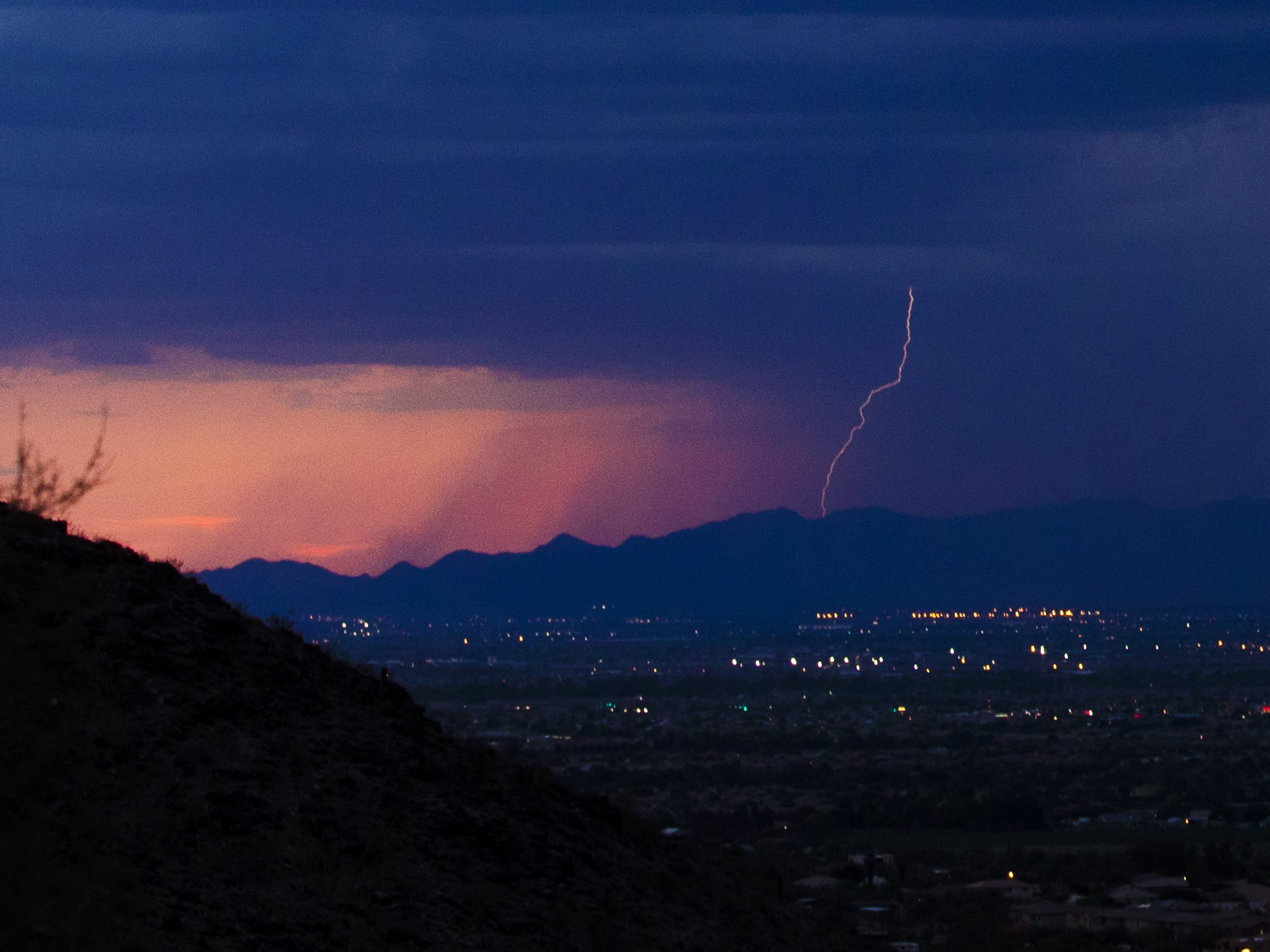 Lightning strikes over the Estrella Mountains near Phoenix on Aug. 8, 2018.