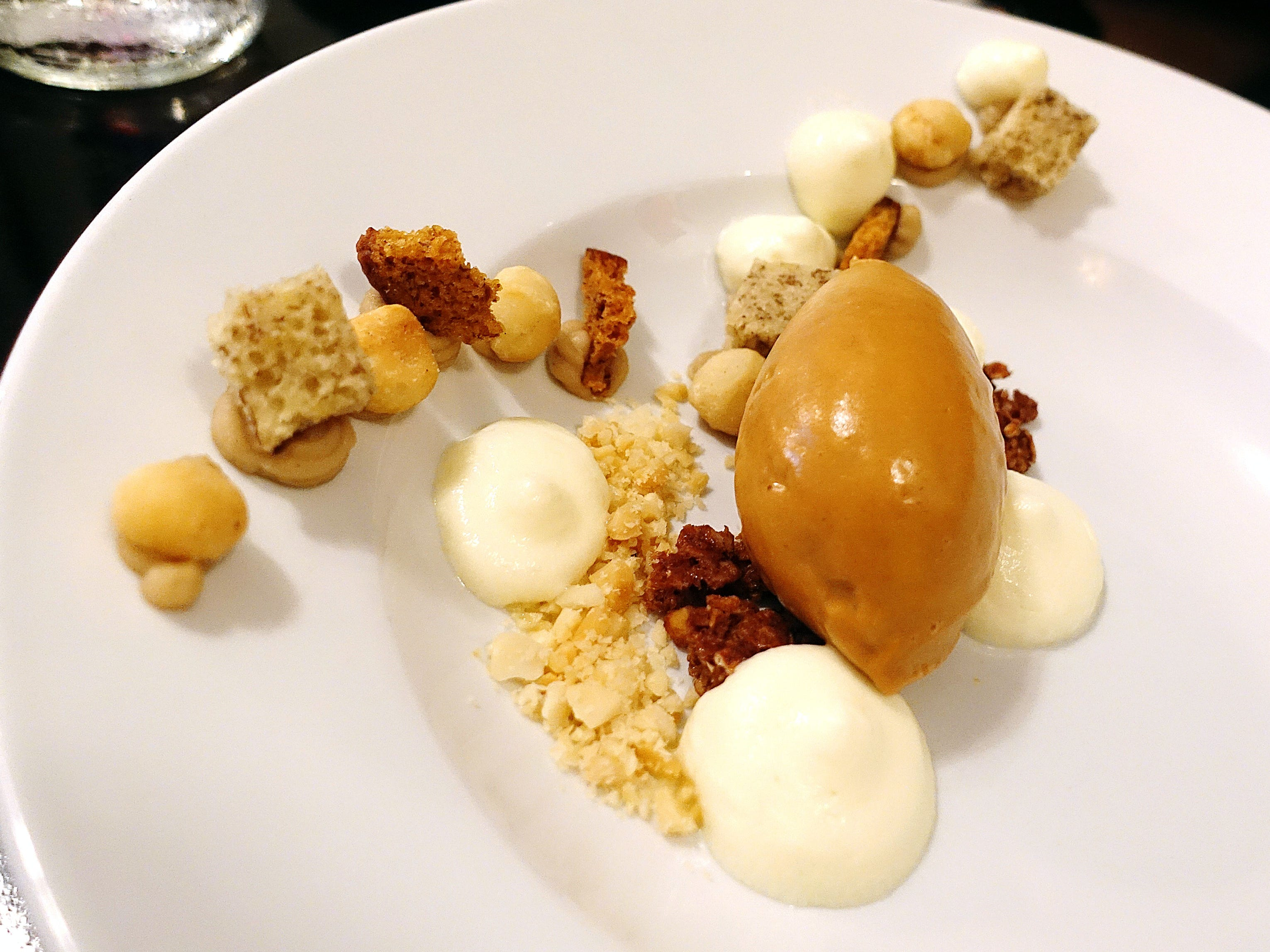 Caramelized white chocolate mousse with macadamia nut and banana bread at Confluence in Carefree.