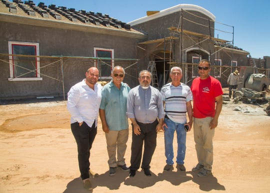 Ephrem Jando (left to right), project manager; Odisho Dinkha, contractor; Rev. Kohshaba Sholimun; Albert Sangar, Church Building Committee member; and William Dinkha, contractor supervisor, stand outside the ongoing construction at the Assyrian Church of the East in Gilbert on May 31, 2018.