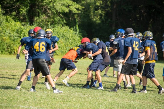 Algonac special teams run drills during a football practice Thursday, Aug. 9, 2018, at Algonac High School.