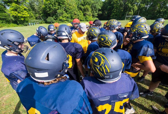 Algonac head coach Scott Barnhart addresses the team during practice Thursday, Aug. 9, 2018, at Algonac High School.
