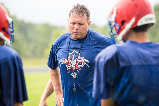 St. Clair head coach James Bishop addresses several players during practice Wednesday, Aug. 8, 2018, at St. Clair High School.