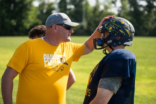 Algonac football coach Scott Barnhart, left, talks to left tackle Joe Ahles during practice Thursday, Aug. 9, 2018, at Algonac High School.