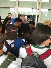 Saquon Barkley signs autographs for the Spackenkill High School football team on Tuesday.