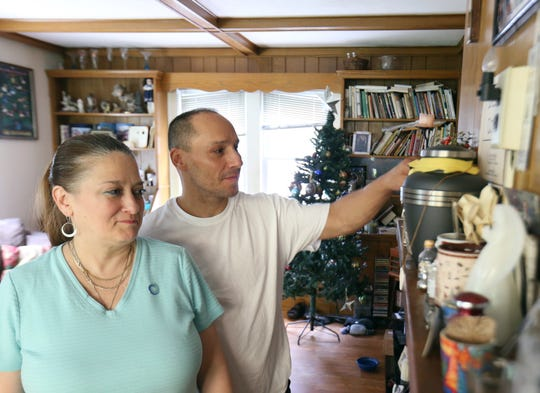 ToniAnn and Fred Colon with the shrine they formed for their son Dillon at their home in the Town of Poughkeepsie on August 9, 2018. Dillon Colon was in a car accident in 2017 and died from his injuries. The Colon family donated Dillon's organs and saved the lives of four people.