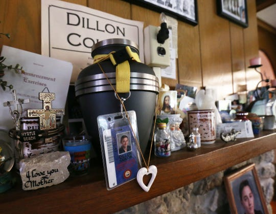 The living room mantle at the home of the Colon family in the Town of Poughkeepsie on August 9, 2018. Their son, Dillon died following a car accident in 2017, and the family set up this memorial to him with an urn containing his ashes, as well as souvenirs and miscellaneous items connected to his life.