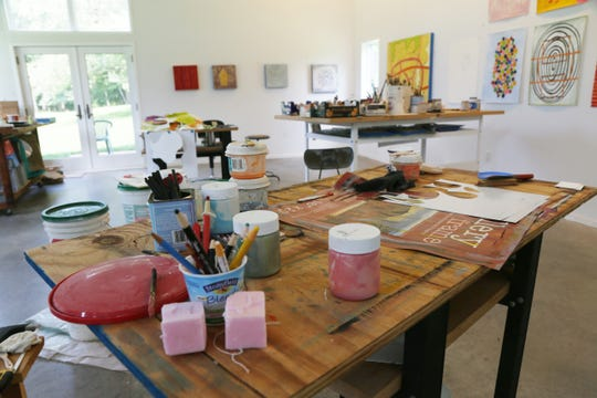 The home studio of Donise English in the Town of Poughkeepsie on August 8, 2018. English utilizes mobile work tables to bring her materials to the art piece.