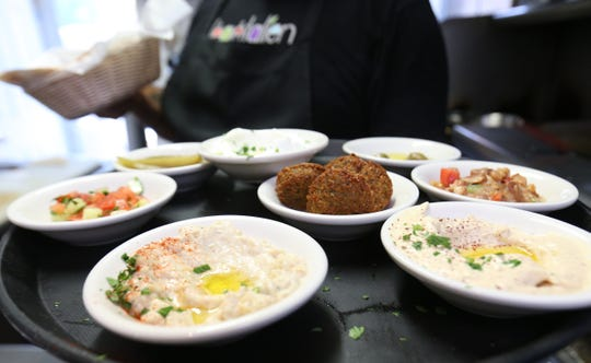 The futur sampler at Ziatun, a Palestinian Middle Eastern restaurant in Beacon on August 8, 2018. The sampler is comprised of hummus, ful medames, baba ghanouj, falafel, turnips, salad and za'atar.