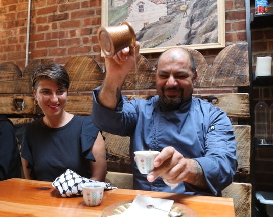 Owners, Lena & Kamel Jamal enjoy a cup of tea after lunch service at Ziatun in Beacon on August 8, 2018.