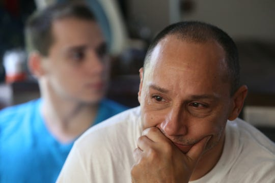 Fred Colon wells up while talking about his son Dillon, while his other son, Erick looks at Dillon's photo at their home in the Town of Poughkeepsie on August 9, 2018. Dillon passed away in 2017 following a fatal car accident. The Colon family decided to donate Dillon's organs and saved the lives of four people.