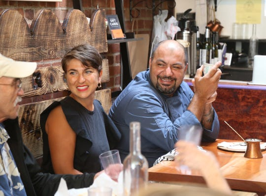 Owners, Lena & Kamel Jamal speak with patrons after lunch service at Ziatun in Beacon on August 8, 2018.