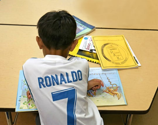 Xavier Martinez reads a book at Morse Elementary School in the Poughkeepsie City School District. Xavier participates in the Summer PAK (Personalized Academic Kit) Program, which a teacher designed to curb the learning loss that students experience over the summer.