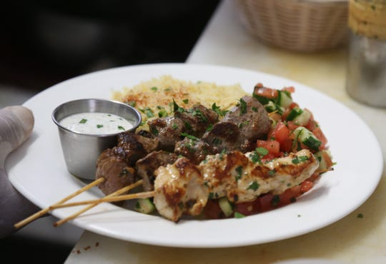 The mixed grill kebab, which is a skewer of chicken, beef & lamb over rice & salad at Ziatun, a Palestinian-Middle Eastern restaurant in Beacon on August 8, 2018.