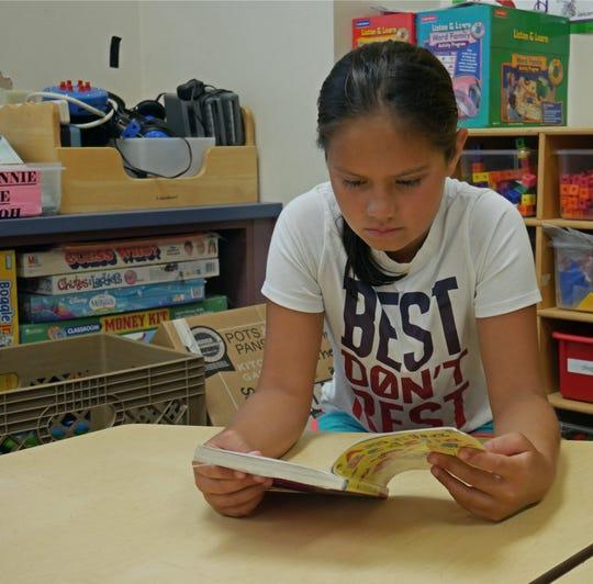 Renata Martinez, a Poughkeepsie City School District student, reads a book.