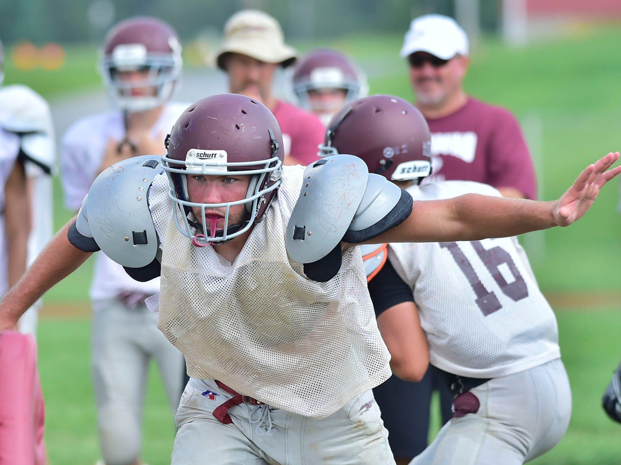 Shippensburg High School football players practice on Thursday, August 9, 2018.