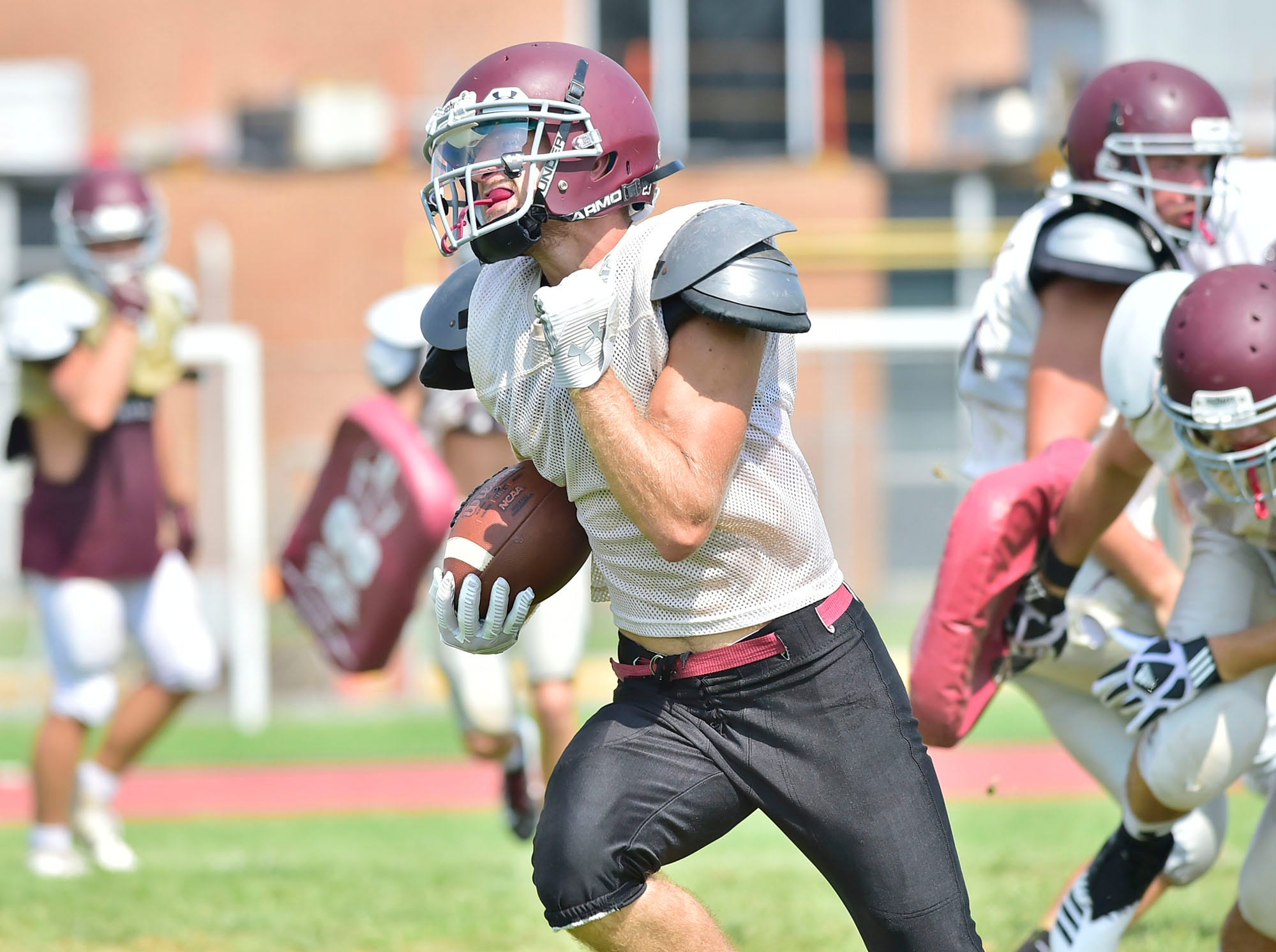 Kyler Brown runs the ball for the Greyhounds. Shippensburg High School football players practice on Thursday, August 9, 2018.