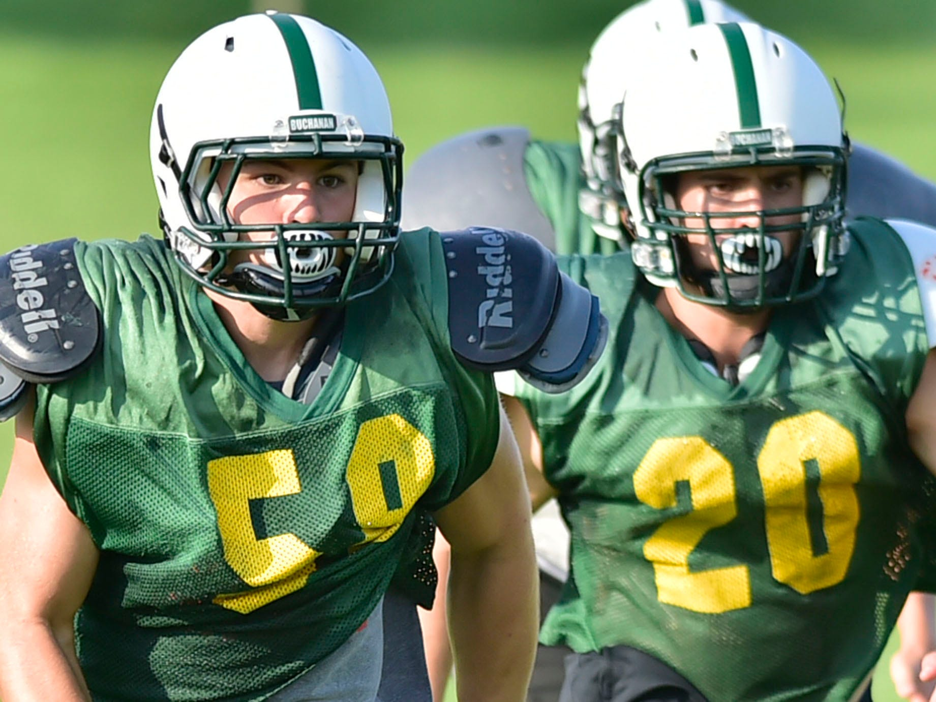 Cormac Houpt, left, and Scott Seburn run trough drills during practice. James Buchanan High School football players practice on Wednesday, August 8, 2018.