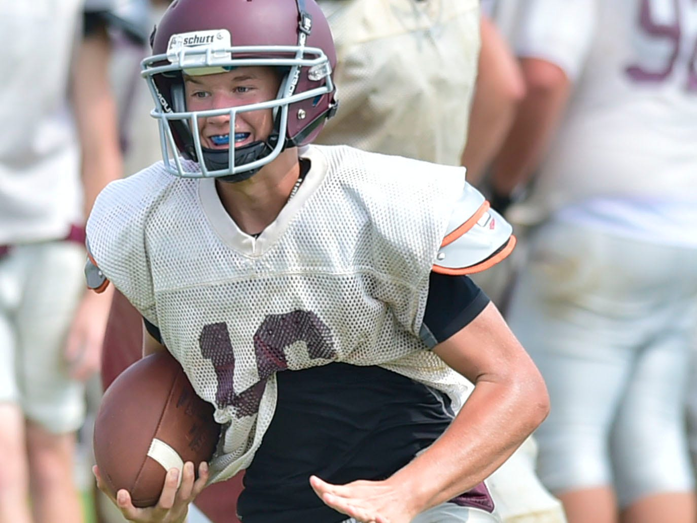 Zach Manning tucks and runs   for the Greyhounds. Shippensburg High School football players practice on Thursday, August 9, 2018.