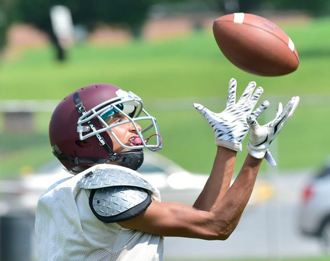 Christian Melendez catches a pass for the Greyhound drills. Shippensburg High School football players practice on Thursday, August 9, 2018.
