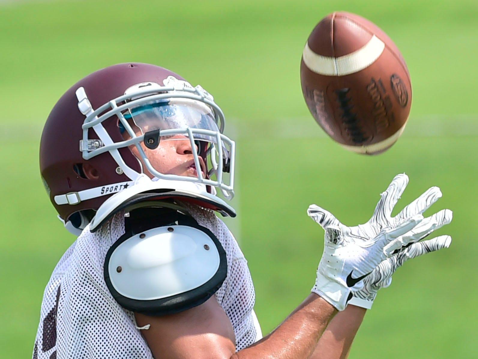 Shippensburg's Christian Melendez hauls in a pass. Shippensburg High School football players practice on Thursday, August 9, 2018.