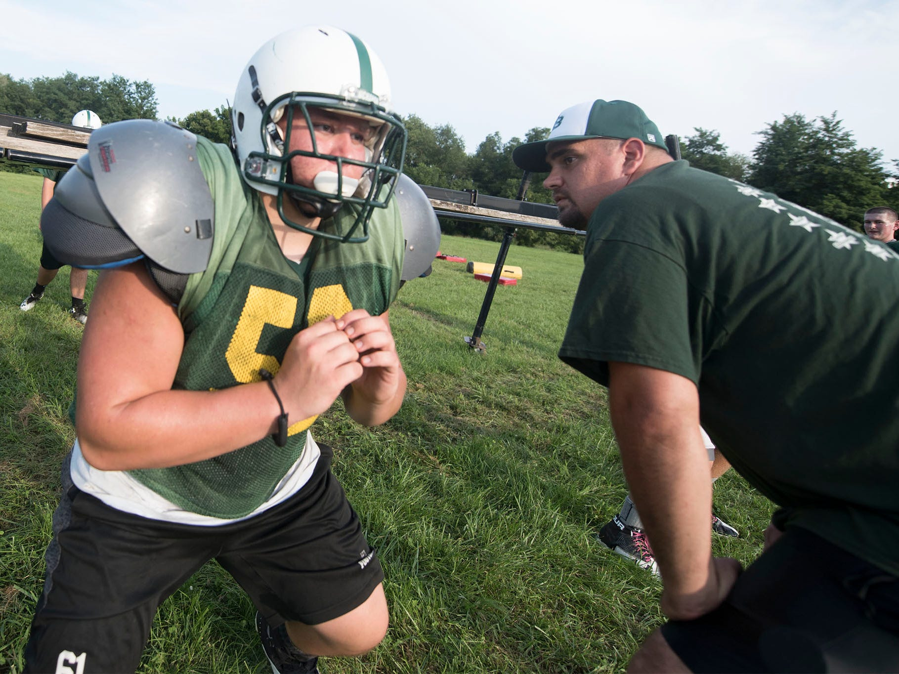 James Buchanan's Logan Spoonhour runs through blocking drills. James Buchanan High School football players practice on Wednesday, August 8, 2018.