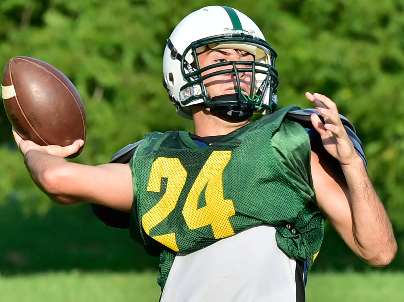 Sabastian Wise thrws the bll during drills for the Rockets. James Buchanan High School football players practice on Wednesday, August 8, 2018.