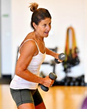 Deb Weaver, of York Township, works with weights during Body Sculpt class at Body Rhythms Life Fitness in Springettsbury Township, Wednesday, Aug. 8, 2018. Dawn J. Sagert
