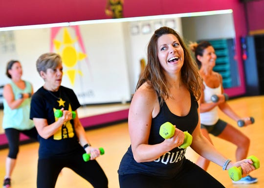 Melissa Eby, of Dover, reacts during Body Sculpt class at Body Rhythms Life Fitness in Springettsbury Township, Wednesday, Aug. 8, 2018. Dawn J. Sagert