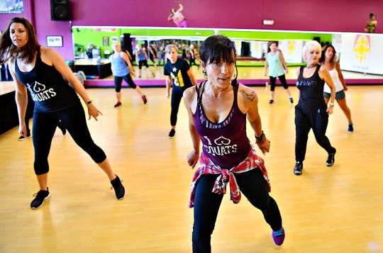 Members move to music during Body Sculpt class, lead by Co-owners Melissa Deitz, of Springettsbury Township, at Body Rhythms Life Fitness in Springettsbury Township, Wednesday, Aug. 8, 2018. The studio, located at 1240 Greensprings Dr., will be offering free classes all day, Saturday, Aug. 11, in honor of their seventh anniversary. Dawn J. Sagert