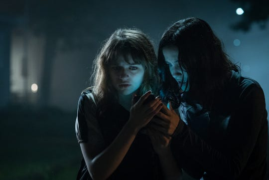 """Joey King as Wren and Julia Goldani-Telles as Hallie in the film """"Slender Man."""" The movie is playing at Regal West Manchester Stadium 13, Frank Theatres Queensgate Stadium 13 and R/C Hanover Movies."""
