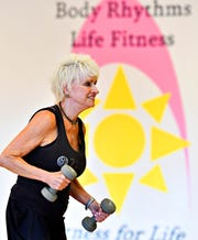 Phyllis Forbes, of West Manchester Township, works with weights during Body Sculpt class at Body Rhythms Life Fitness in Springettsbury Township, Wednesday, Aug. 8, 2018. Dawn J. Sagert