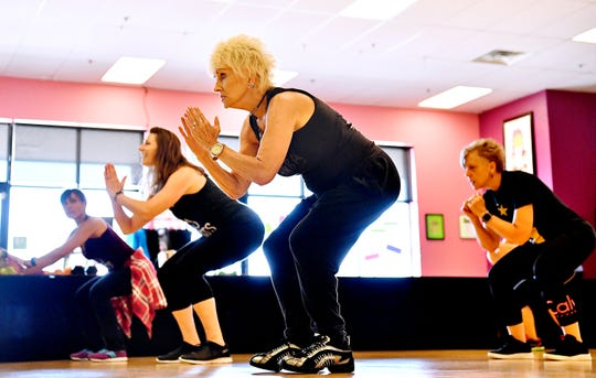 Phyllis Forbes, center, of West Manchester Township, moves during Body Sculpt class, lead by Co-owners and sisters, Monica Melendez, of York City and Melissa Deitz, of Springettsbury Township, at Body Rhythms Life Fitness in Springettsbury Township, Wednesday, Aug. 8, 2018. In honor of their seventh anniversary, the studio, located at 1240 Greensprings Dr., will be offering free classes all day, Saturday, Aug. 11. Dawn J. Sagert