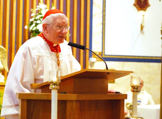 Cardinal William Keeler makes remarks before the end of a Sunday Mass at St. Mary's in this 2010 file photo.