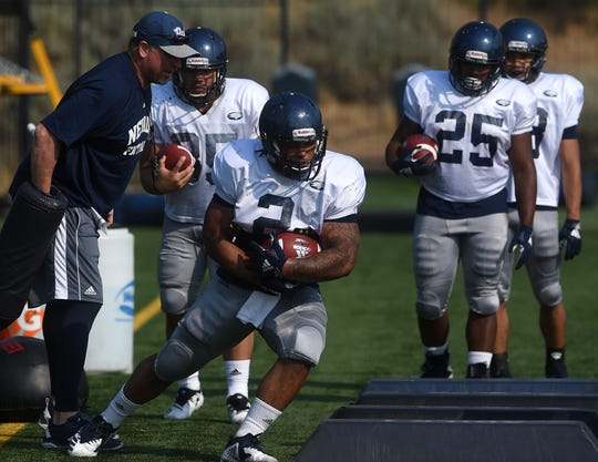 Nevada running back Devonte Lee carries the ball during practice on Monday.