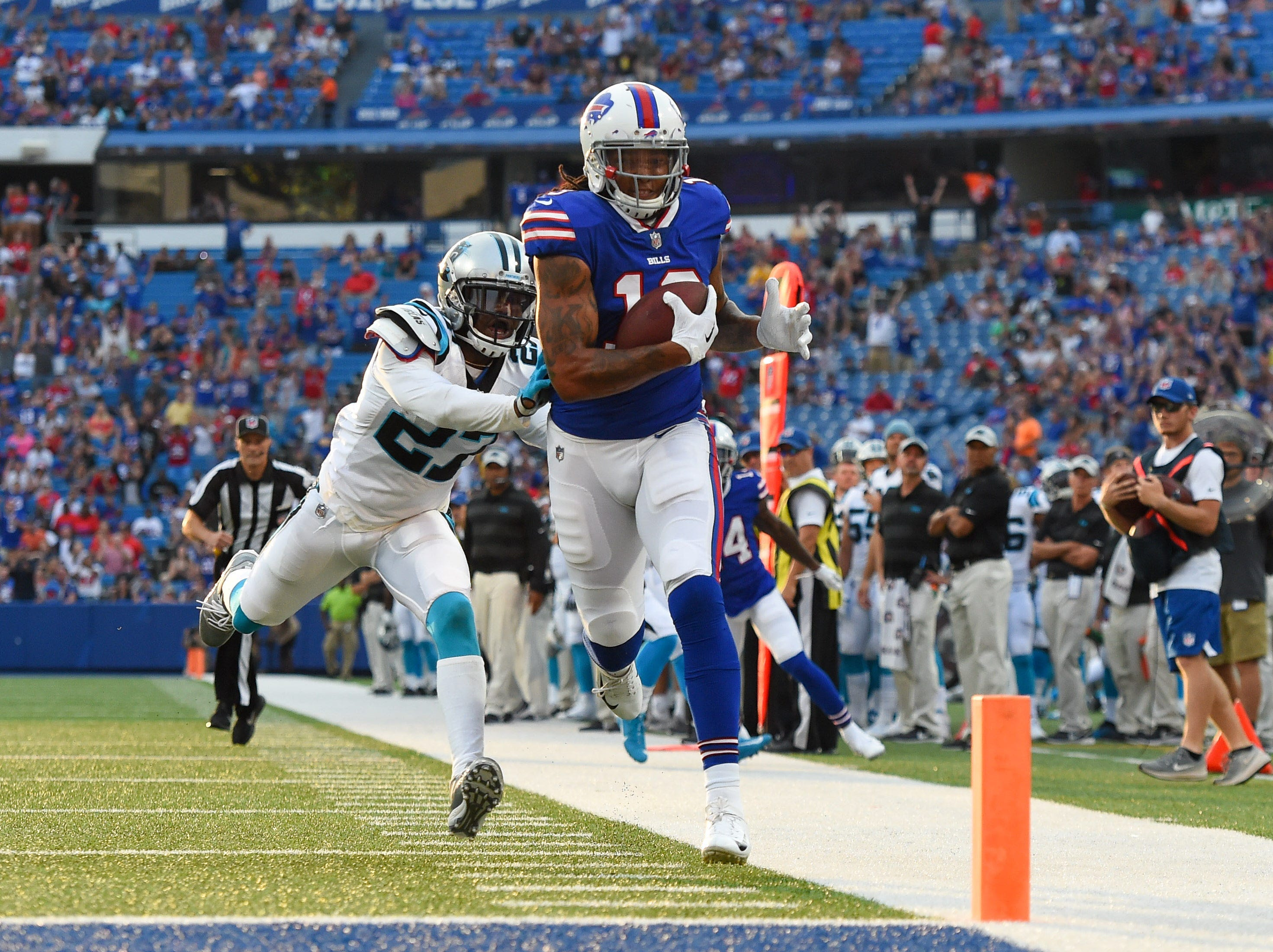 Aug 9, 2018; Orchard Park, NY, USA; Buffalo Bills wide receiver Kelvin Benjamin (13) runs into the end zone for a touchdown in front of Carolina Panthers cornerback Kevon Seymour (27) during the first quarter at New Era Field. Mandatory Credit: Rich Barnes-USA TODAY Sports