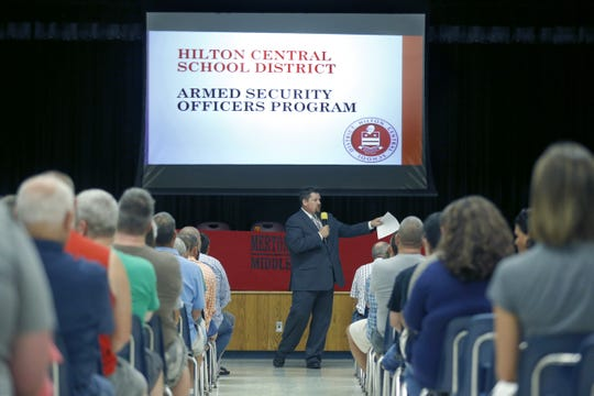 Casey Kosiorek, superintendent of Hilton schools, makes the introductions during a public meeting last week on the possibility of Hilton schools potentially getting armed guards, at Merton Williams Middle School.