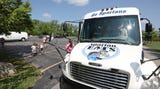 The Gates Chili School District is using a renovated school bus to deliver meals to students at four locations throughout the summer.
