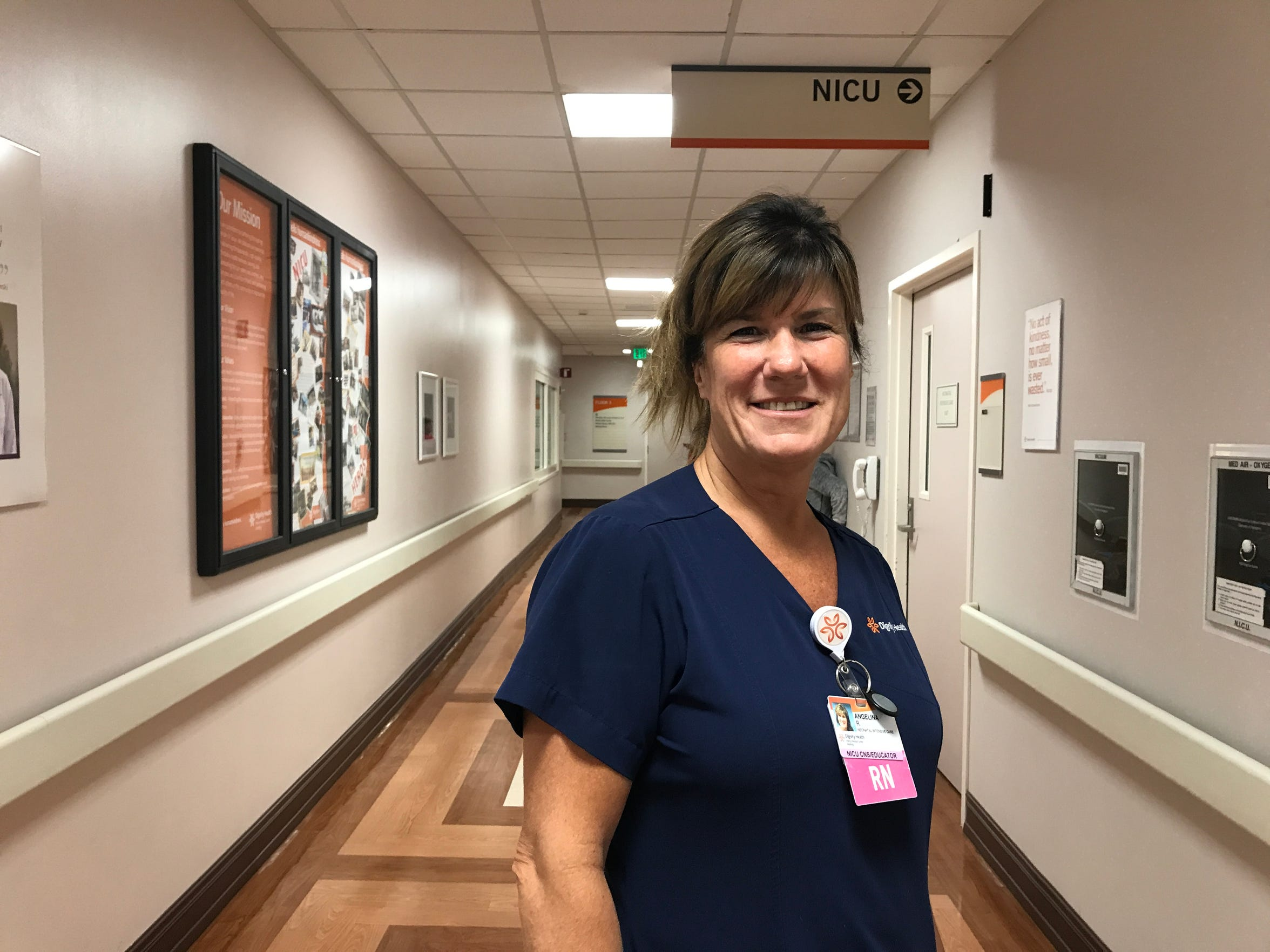 Nurse Angelina Robinson-Faxon stands in the hallway of Mercy Medical Center's neonatal intensive care unit in Redding August 8, 2018.