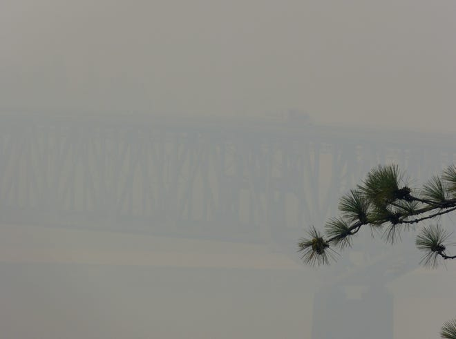 The Pit River Bridge over Lake Shasta was obscured by smoke Thursday from the Carr Fire and other fires burning throughout Northern California, including the Hirz Fire north of Redding. The thick smoke made for unhealthy air quality all over the North State.