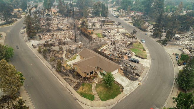 An aerial view of the homes of Harlan Drive and Bedrock Lane in the Lake Redding Estates neighborhood show the devastation caused by the Carr Fire which roared through the area late last week. The area remains closed to residents as crews work to restore some of the infrastructure in the area. The fire has burned more than 162 square miles and destroying more than 1,100 structures, is the most destructive fire in Shasta County history.