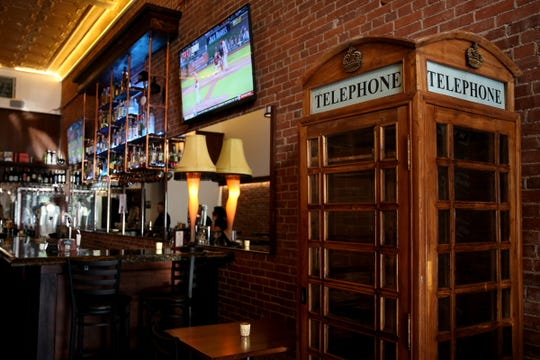 A telephone booth is part of the decor at W. Wallace in downtown Salem on Wednesday, Aug. 8, 2018.