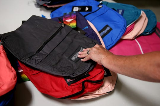 Volunteers fill backpacks with school supplies at Salem Elks Lodge 336 on Sunday, Aug. 5, 2018.