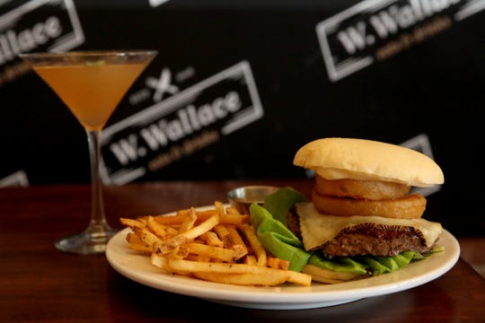 The W. Wallace burger with Cajun fries and the Pony Express cocktail at W. Wallace in downtown Salem on Wednesday, Aug. 8, 2018.